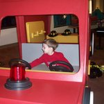 "My son ""driving"" the fire engine"