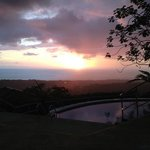 sunset over the ocean from the pool