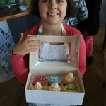 amy delighted with her cupcakes