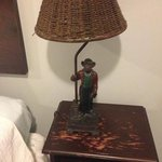 strange bedside lamps and peeling night stand