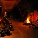 Courtyard with firepit outside Albuquerque Room at night