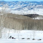 Sarah drives her sled with the stunning Yampa Valley in the background!