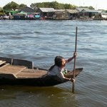 young girl paddles out to meet our boat.  Battambang to Siem Reap boat trip.