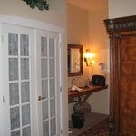 French doors of the closet, and hallway, taken from bedroom