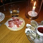 Our delicious oysters and Serrano ham