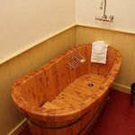 Luxuriate in a beautiful wooden tub, reminiscent of the 1800s in room 1.