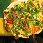 Pizza rucola, pachino e grana