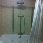 Jacuzzi Bath and Overhanging Shower
