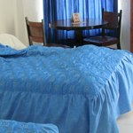 double beds with dated bedding