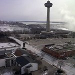 The US falls views - the Skylon Tower - and to the right the mist of the Canad