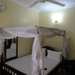 Good quality mosquito nets, aircon and fan, desk and internet available in rooms