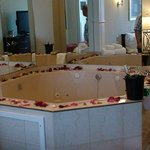 The jacuzzi with the petals and wine