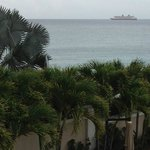 Cruise ship arrives in distant port.