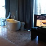 big bath tub in the living room by the window, great view of the strip while soaking in the tub