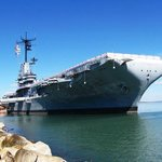 USS Lexington is anchored near hotel