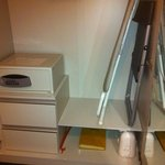 Wardrobe including safety deposit box, iron, ironing board, spare foldout chai