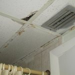 Water damaged ceiling, visible hole