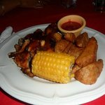 Barbeque chicken with wedges and corn