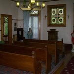 In the chapel. Can you find the orb on the pew?