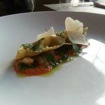 Smoked mushroom agnolotti, charred pepper nage and arugula walnut pesto