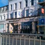 Big pub in old bank building beside dual carriageway