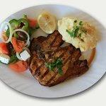 T-bone pork steak with mash potato and salad