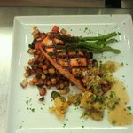 Agave glazed grilled Salmon topped with a Citrus & Tomatillo salsa on a Butternut and Poblano sa