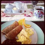 Local sausages wrapped in gluten-free pancakes and scrambled eggs, delish!