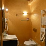Orange bathroom in the BLue & Black Suite