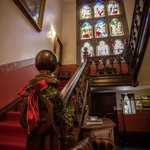 Red Staircase & Stained Glass Window