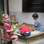 Kid's sandbox outside in the courtyard.  Nicely shaded and cool on a hot summe