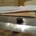 Raised screws between bedroom and bathroom