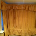 Huge curtains that don't shut fully
