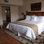 Comfortable bedding, rug, and tile floors