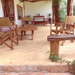 Mara House veranda, cozy sofas to sit on to watch the watering hole.