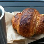 huge croissant and coffee