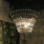 Chandelier in lobby, made of simple and plain glass bottles
