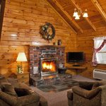 Family Log Cabin Living Room w/real woodburning fireplace