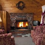 Honeymoon Log Cabin living room w/real wood burning fireplace
