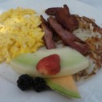 Wild Boar Bacon with Fresh fruit and Scrambled Egg.