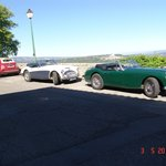 There are old roadsters at Le Terrace cafe of Bonnieux
