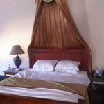 Colonial style furnishing and clean bed linen