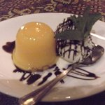 Mango pudding with ice cream and chocolate sauce