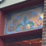 Stained Glass Panel Near The Courier Cafe's Main Entrance