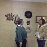 Liz chats with town staff member Amy while installking her Earth Spirits