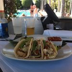 Mahi Mahi tacos by the pool
