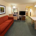 Suites feature adjoining living rooms for additional space.