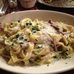 Fettuccini with Prosciutto & Peas in a garlic cream sauce