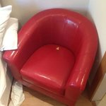 Pointless chair in tiny room. Would prefer bigger bed