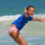 Yep, and they taught her proper surfer wave etiquette!